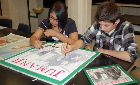 Library displays student artwork on ceiling tiles