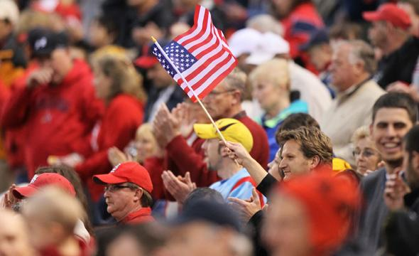 A fan waves an American flag at Busch Stadium before the singing of the National Anthem as the public announcer describes the events of the past 24 hours including the death of Osama bin Laden. The St. Louis Cardinals faced the Florida Marlins on Monday, May 2, 2011, in St. Louis, Missouri. (Chris Lee/St. Louis Post-Dispatch/MCT)