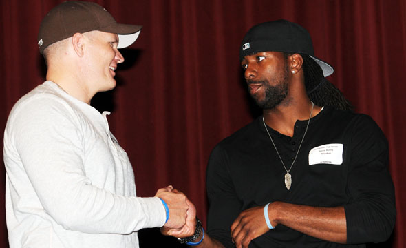 Dallas Cowboys players, Rapper pays visit to sophomore class for motivational speeches