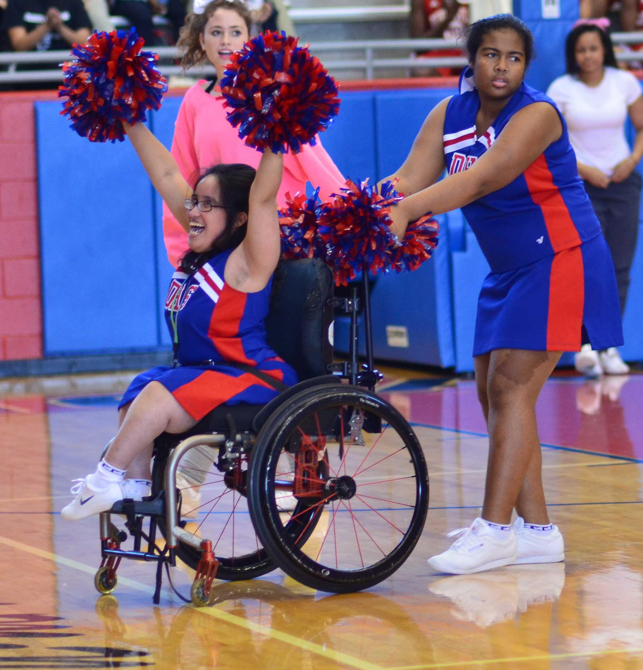 Senior Sparklers Cheer captain Genesis Montanez pumps up the crowd as she chants