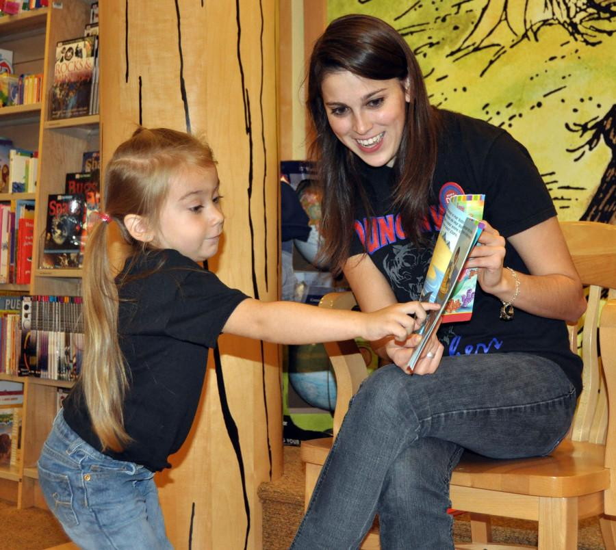 Last+year+student+council+members+read+to+students+at+the+book+fair.++The+younger+children+assisted+the+older+in+the+reading+of+popular+children%27s+books.+%28Chrystal+Rhone+Photo%29