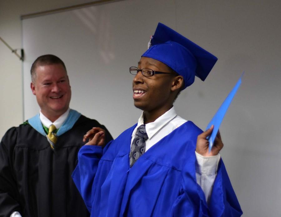 Deuntae+Pegues+gives+a+shout+out+to+all+those+who+helped+him+obtain+his+diploma+from+Duncanville.++He+moved+to+PACE+learning+center+after+being+diagnosed+with+a+brain+tumor+that+affected+his+motor+skills.+He+recently+graduated+with+his+classmates+from+PACE.+%28Xavier+Goode+photo%29
