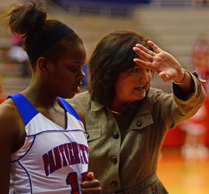 Coach Cathy Self-Morgan demonstrates a play during a timeout in the South Grand Prairie game. (Cody Rogers Photo)