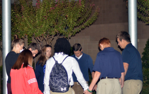 Students gather at the base of the flagpole to pray together on National See You at The Pole Day. (Kennedy Stidham photo)