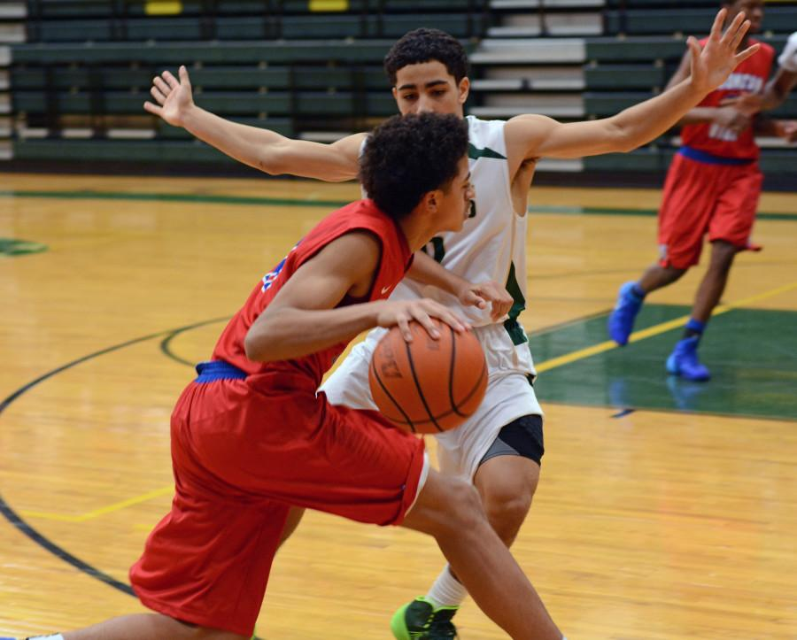 Senior+Jalen+Harris+drives+the+ball+in+line+against+a+Desoto+defender+in+a+previous+season.+%28Photo+by+Olivia+Davila%29