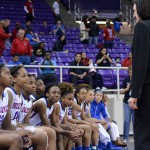 Pantherette head coach Cathy Self-Morgan shares a winning moment with her seniors on the bench at the end of their 70-29 blowout over LD Bell in the Region 1 Finals game. (Olivia Davila photo)