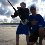 Joseph poses with his son Jackson as he reels in a fish from the shore. (Submitted photo)