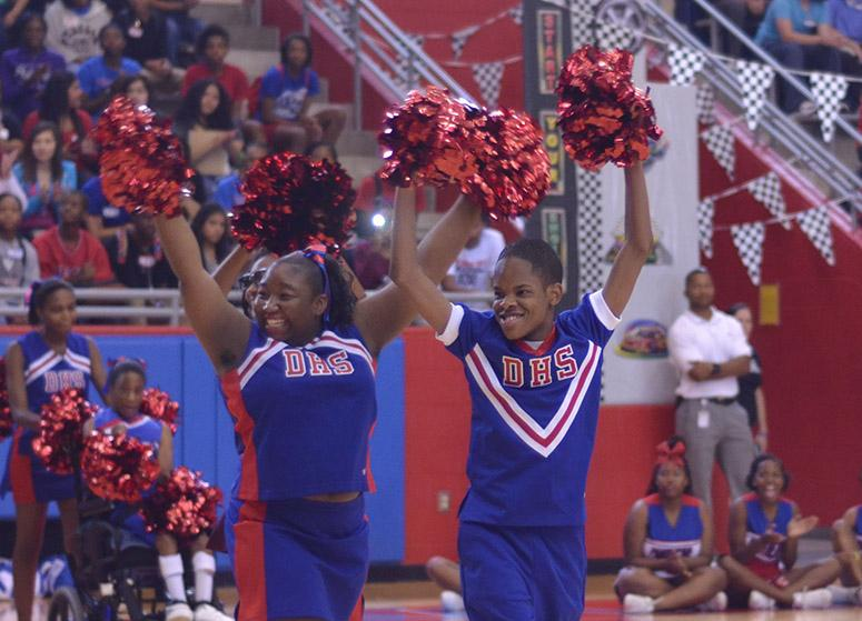 Sparkler+Cheerleaders+pump+up+the+crowd+at+a+pep+rally.+They+received+a+standing+ovation+at+every+event+they+cheered+at+this+year.+%28Tomica+Charles+photo%29