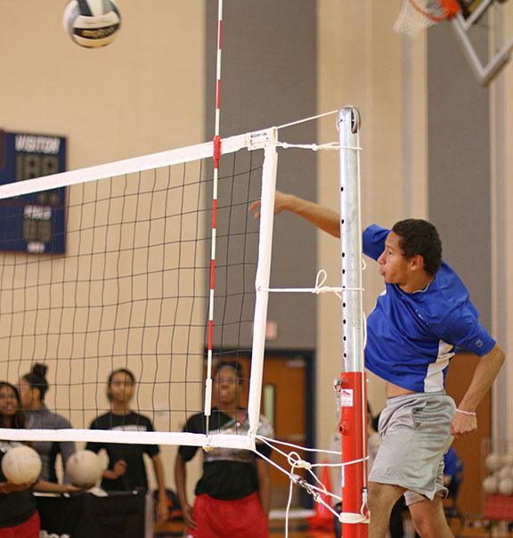 Senior+Alexander+Fuentes+spikes+the+ball+over+the+net+during+Powderbuff+practice.+%28Photo+by%3A+Kyhia+Jackson%29