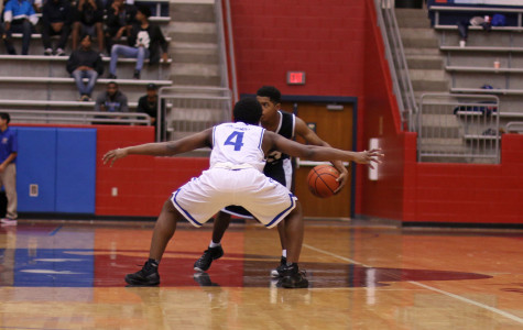 Varsity boys basketball competes with South Grand Prairie