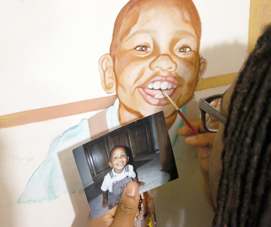 Senior+Kalen+McGuire+focuses+his+eyes+on+the+final+touches+of+his+painting+of+himself.+%28Trevon+McWilliams+photo%29