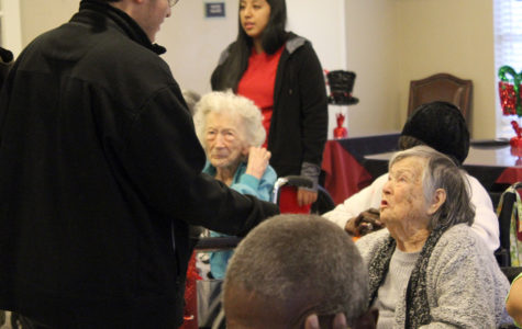 Interact club spreads Christmas cheer to local nursing home