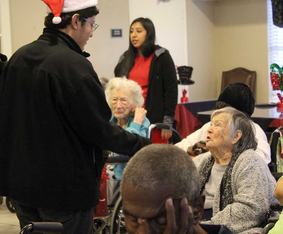 Students from the Duncanville High School Interact club visited the Laurenwood nursing home to spread some holiday cheer. (Gloria Ogonlade photo)