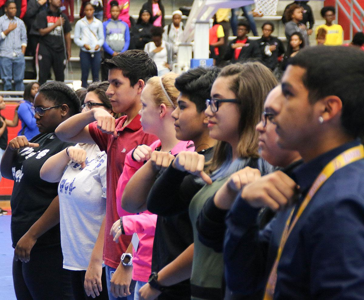 Students from ASL club sign the National Anthem during a recent pep rally. (Photo by Emlyn Almanza)