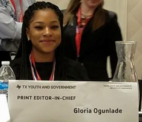 Gloria Ogunlade takes her seat at the table as newly elected Youth and Government Editor-In- Chief. (Dianne Williams photo)