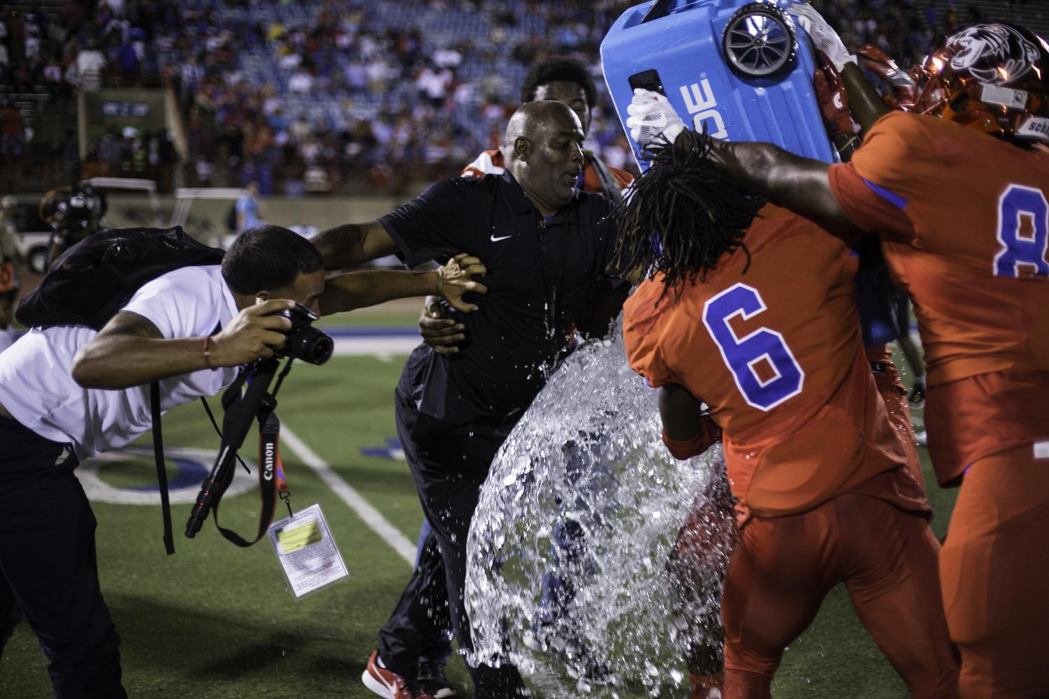 Head Coach Reginald Samples attempts to dodge a water bath after a big win against Skyline. (Brenda Arana photo)
