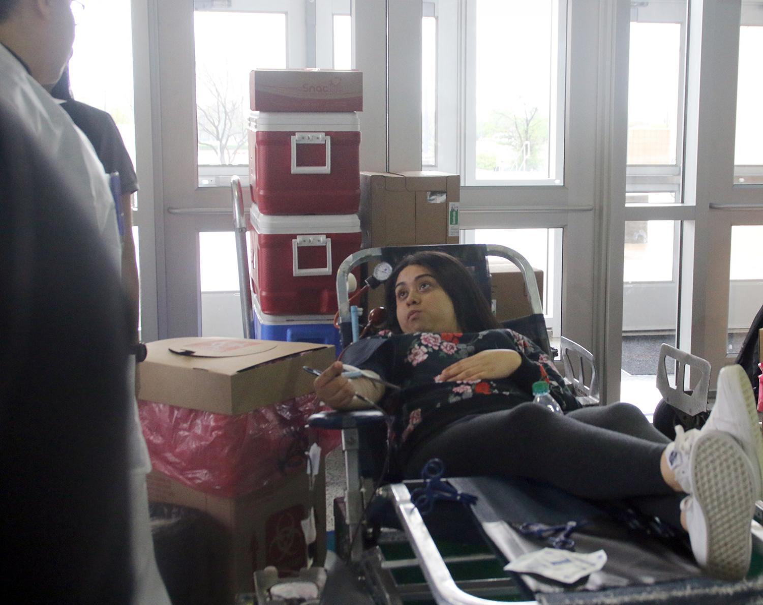 Students give blood during the final blood drive of the school year. (Josefina Soto photo)