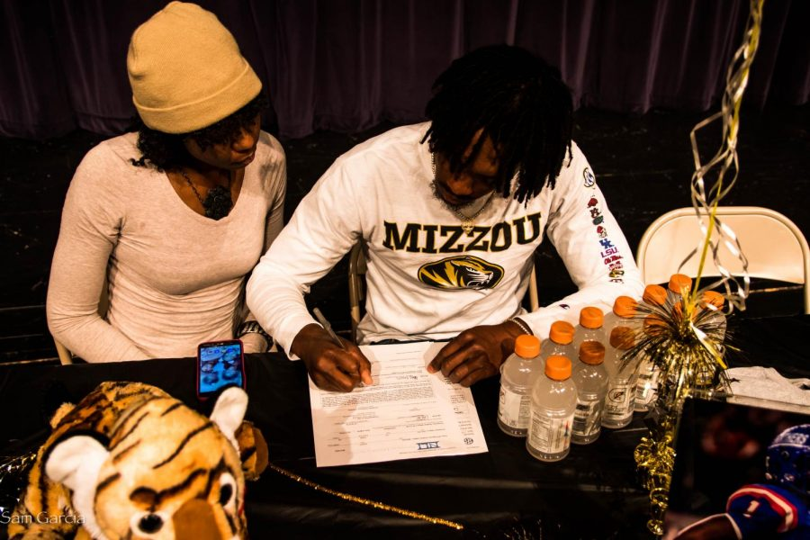 Senior Stacy Brown with his mother signing his letter of intent to Missouri.