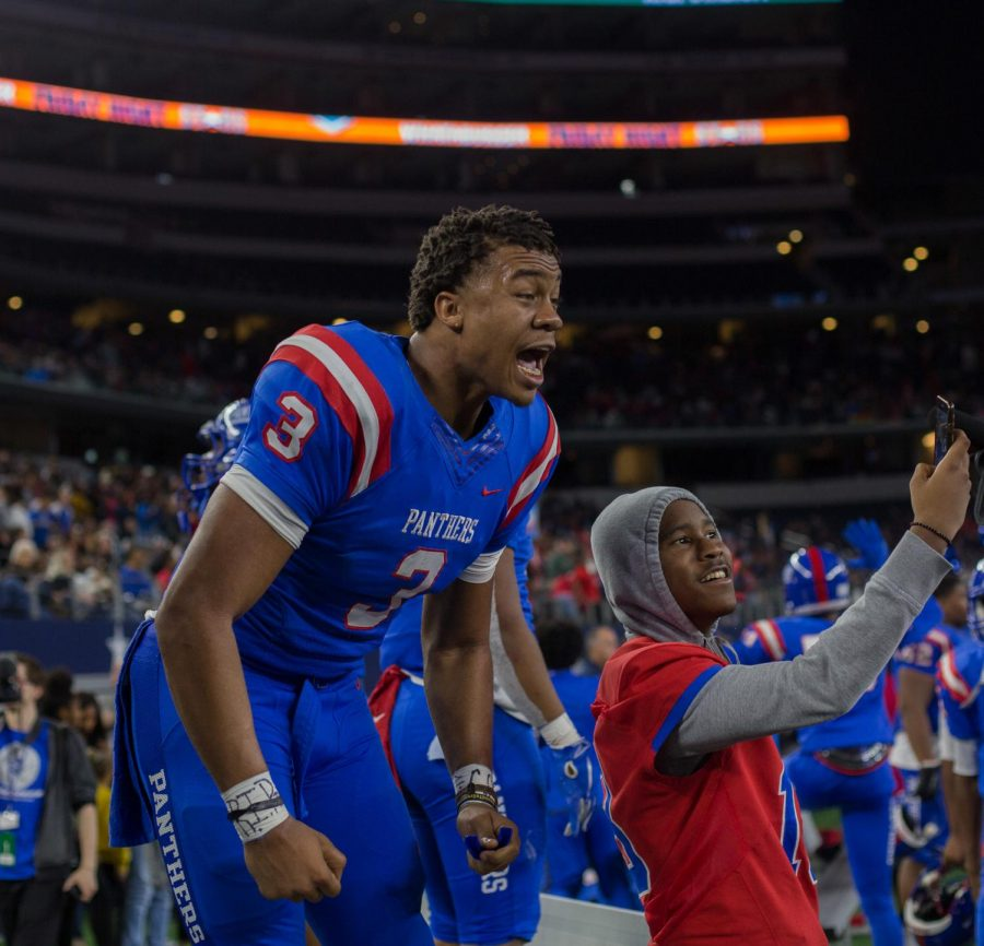 Jaquenden Jackson celebrates  on the sideline at AT&T Stadium after Duncanville takes the lead in the fourth quarter vs Allen in the UIL state semifinals vs Allen.