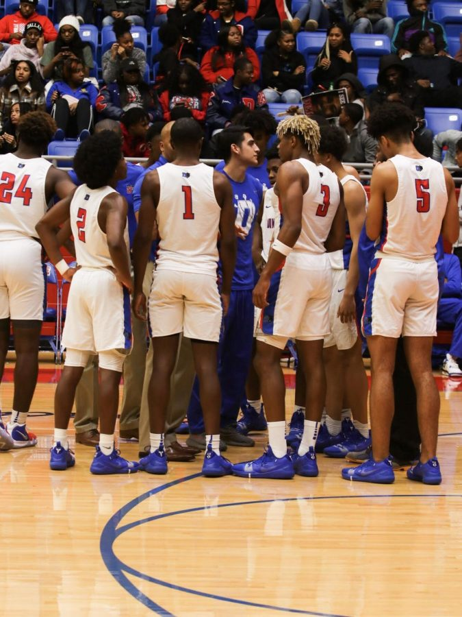 The Duncanville Varsity Basketball team gathers during a timeout.