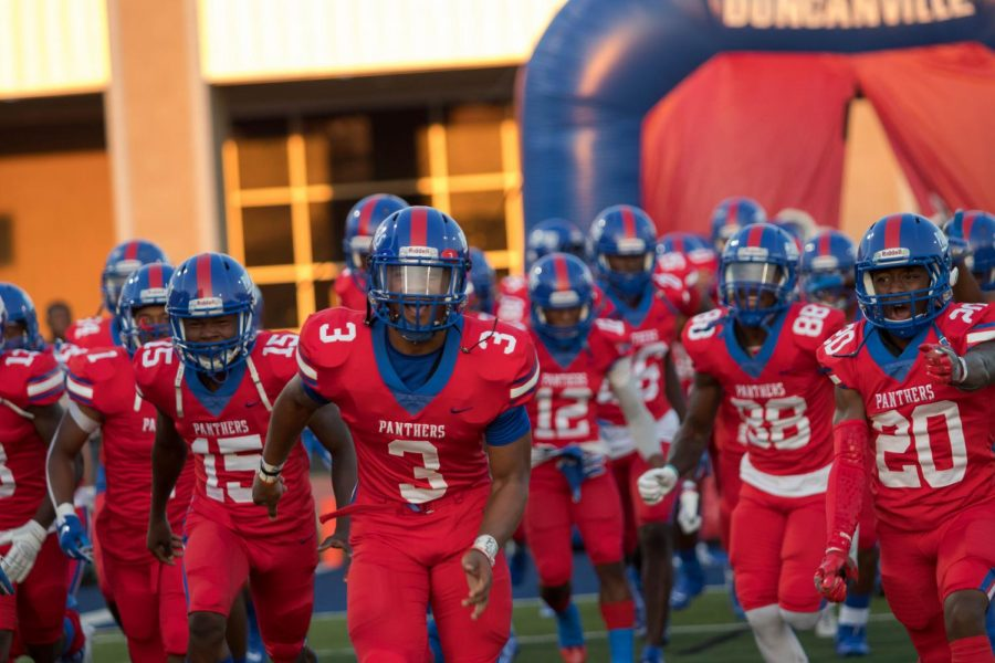 The Duncanville players take the field.