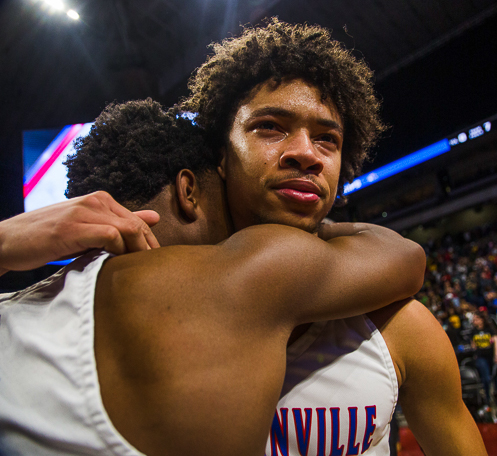 Senior Miles Bennett embraces Christian Mithcell after winning the state championship.