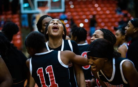 The Pantherettes celebrate after their big win against Desoto in Round 3.