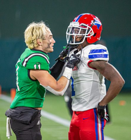 Southlake player Josh Spaeth (11) consoles Chris Hicks Jr. (1) following the Dragons defeat of Duncanville.