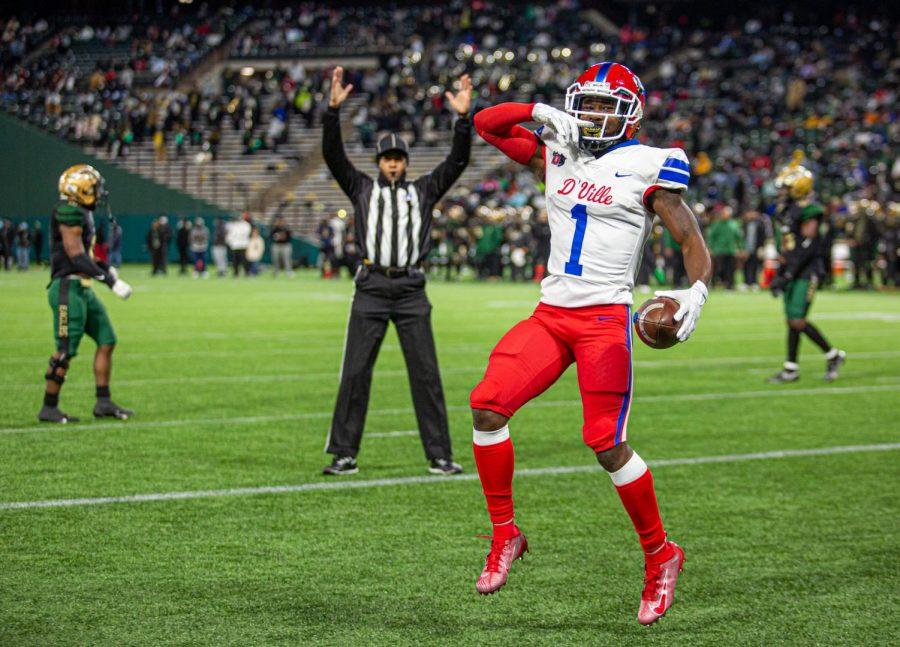 Chris Hicks Jr. (1) celebrates after scoring a touchdown vs Desoto.