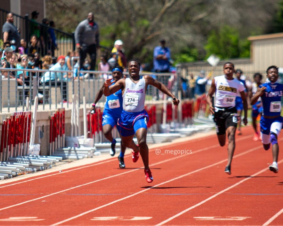 Senior Roderick Daniels limps across the finish line at the Region 2 finals in Waco.