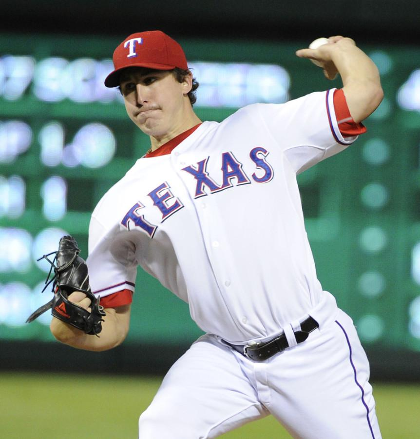 Texas+Rangers+starter+Derek+Holland+%2845%29+pitches+against+the+Detroit+Tigers+during+Game+6+of+the+American+League+Championship+Series+in+Arlington%2C+Texas%2C+Saturday%2C+October+15%2C+2011.+%28Max+Faulkner%2FFort+Worth+Star-Telegram%2FMCT%29
