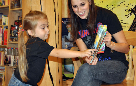Last year student council members read to students at the book fair.  The younger children assisted the older in the reading of popular children's books. (Chrystal Rhone Photo)
