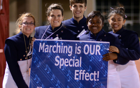 At the final football game of the season, a group of parents made signs for the band.(Olivia Davila photo)