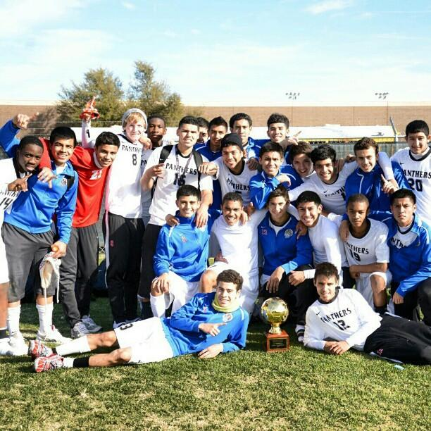 The+Panther+soccer+team+takes+the+time+for+a+photo+with+their+championship+trophy.+%28Ariana+Canchola+photo%29