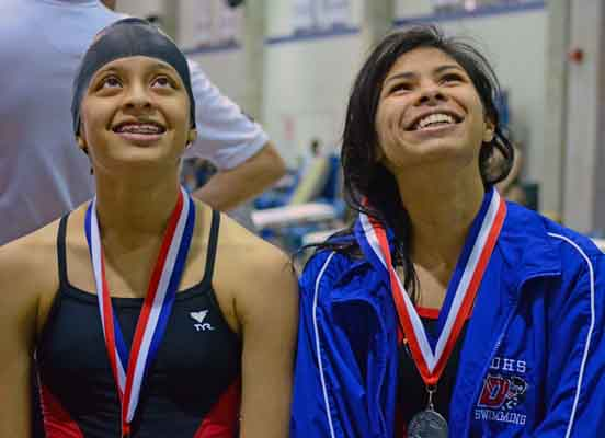 The girls swim team finished second overall in the district meet. Several girls finished with personal best times. (Chrystal Rhone photo)