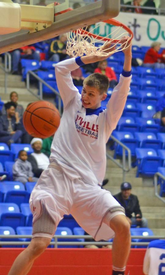 Sophomore+Matt+McQuaid+dunks+the+ball+in+warmup+against+Mansfield.+%28Chrystal+Rhone+photo%29
