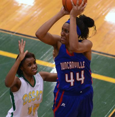 Senior Antoina Robinson shoots for two against Desoto. (Cody Rogers photo)