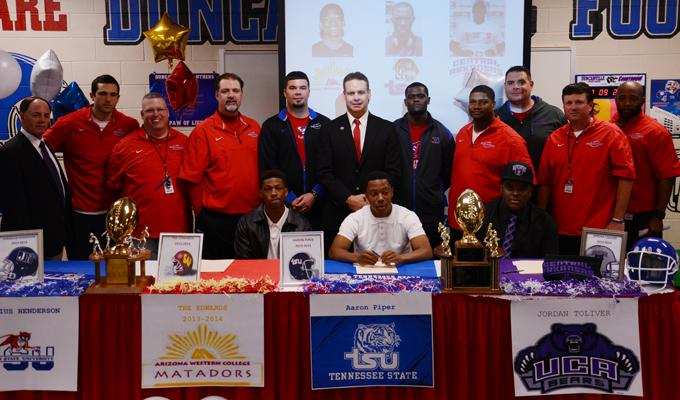 Six+studendts+signed+their+letter+of+intent+to+play+college+football+today.+Pictured+are+Tre+Edwards%2C+Arizona+Western%2C+Aaron+Piper%2C+Tennessee+State+University+and+Jordan+Toliver%2C+University+of+Central+Arkansas.+%28Ariana+Canchola+photo%29