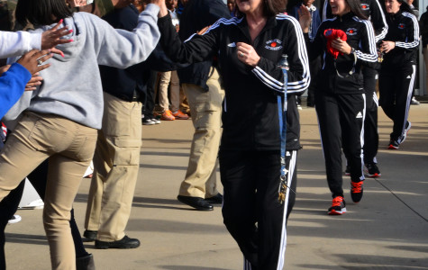 Coach Self-Morgan high fives fans as she heads to the bus for the state tournament (Tricia Virtue)