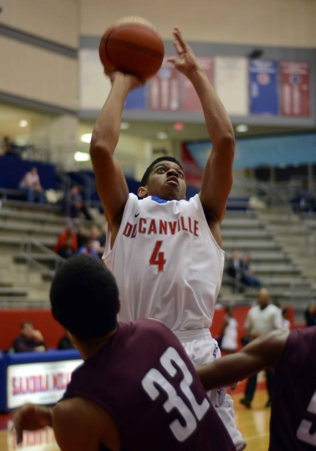 Junior DJ Wallace goes up for the basket against Mansfield Timberview. (Abigail Padgett photo)
