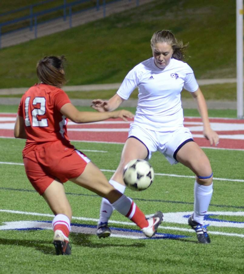 Senior Hannah Henton fights for the ball against Belton in the first round of the playoffs. The team will now face Hebron. (Lisette Lopez photo)