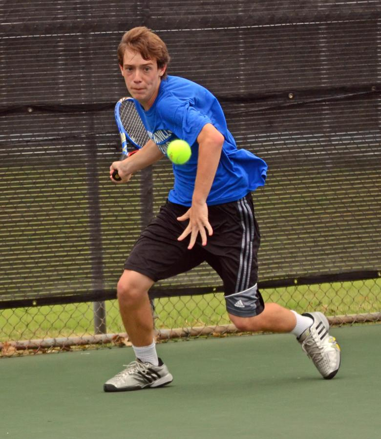 Sophomore Gavin Beach prepares to hit a forehand during the district finals