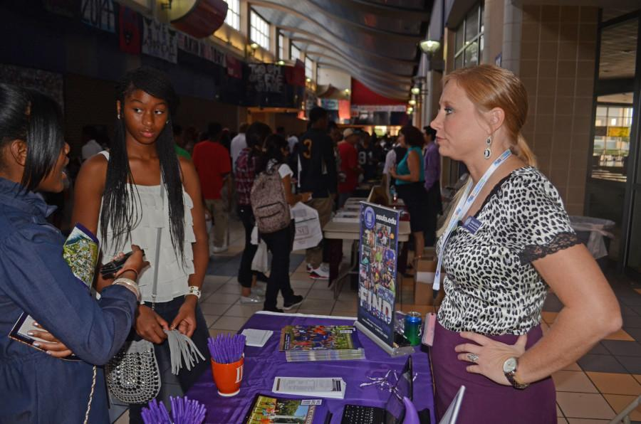 Students talk to college representatives at a previous college night. (Photo by Brandon Rogers)