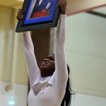 """High Hat Captain Jamelle Brown salutes her Co-Captain Tasmia Allen who lost her life in a Domestic Violence shooting shortly before the start of school. The salute to her photo was part of their grand finale.  The team honored her with a special dance titled """"I Was Here,"""" at their showoff night. (Karla Estrada)"""