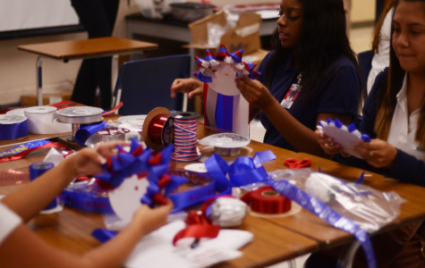 Floral Design classes make mums for homecoming week. (Sean Kirby photo)