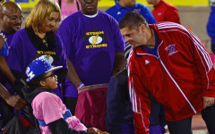 Malone makes monumental return to Panther Stadium after domestic violence attack