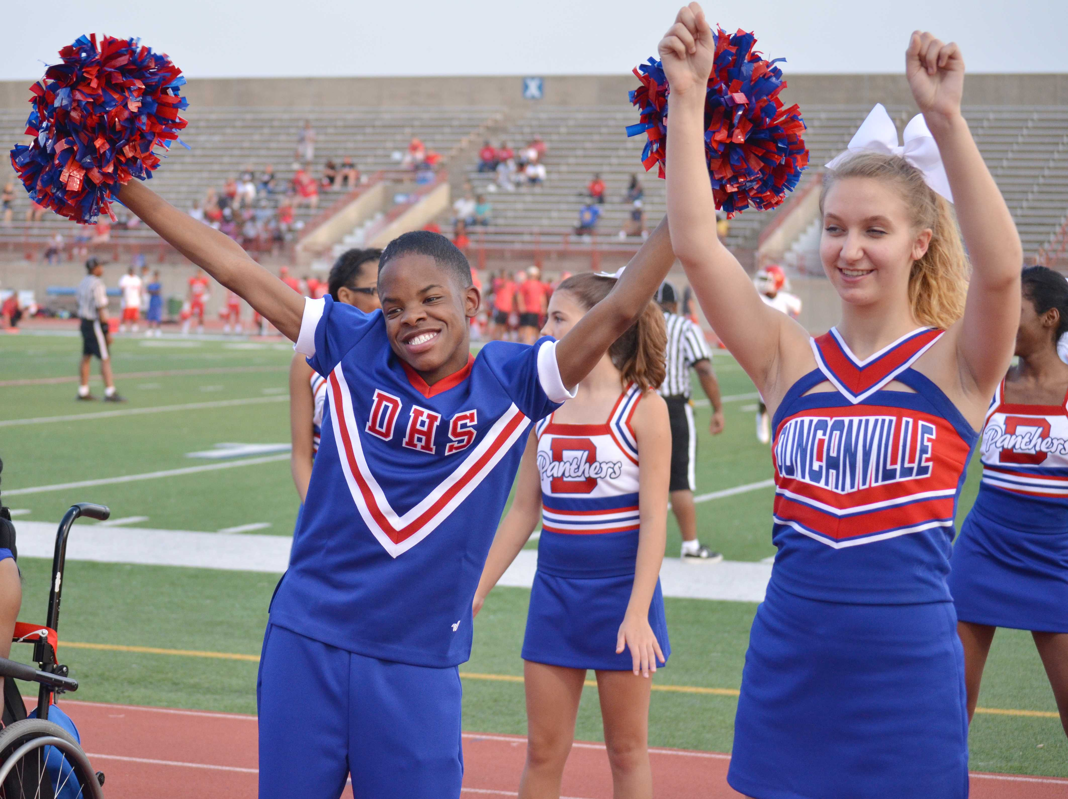 Damion  Jordon dances to a cheer with a varsity cheerleader at a junior varsity game.  Jordan has Autism but comes out of his shell when he is on the field or at a pep rally as a Sparkler cheerleader. (Mireya Ibarra photo)