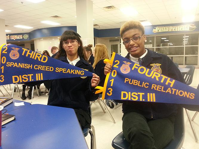 Vanessa Sanchez(left) and Ivana Gossett take the time to show off their winning banners for the recent contest. (submitted photo)