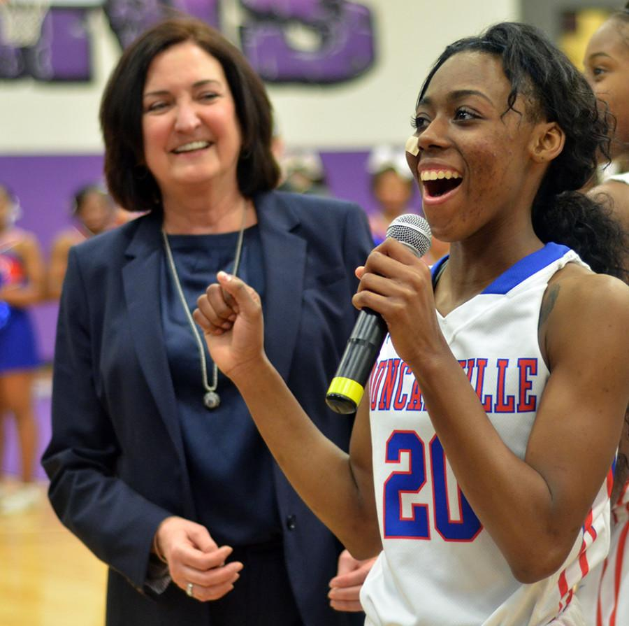Coach+Cathy+Self-Morgan+stands+behind+Texas+signee+Tasia+Foman+as+her+and+the+team+thank+fans+for+their+support+on+the+road+to+consecutive+win+number+100+against+Killeen+Harker+Heights+in+the+area+round+of+playoffs.++The+team+now+has+win+number+101+and+is+looking+to+be+in+the+State+Tornament+again+this+year.+%28Olivia+Davila+photo%29