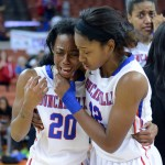 Senior Ariel Atkins consoles senior Tasia Foman after their hopes of a 3 peat championship came to an end with a 56-51 loss to Manvil in the State Championship game. (Karla Estrada Photo)